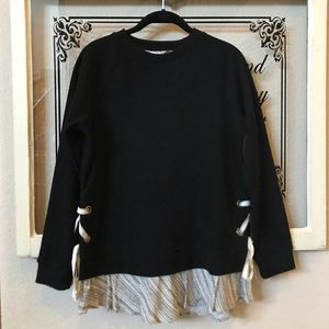 Black sweater with patterned detail